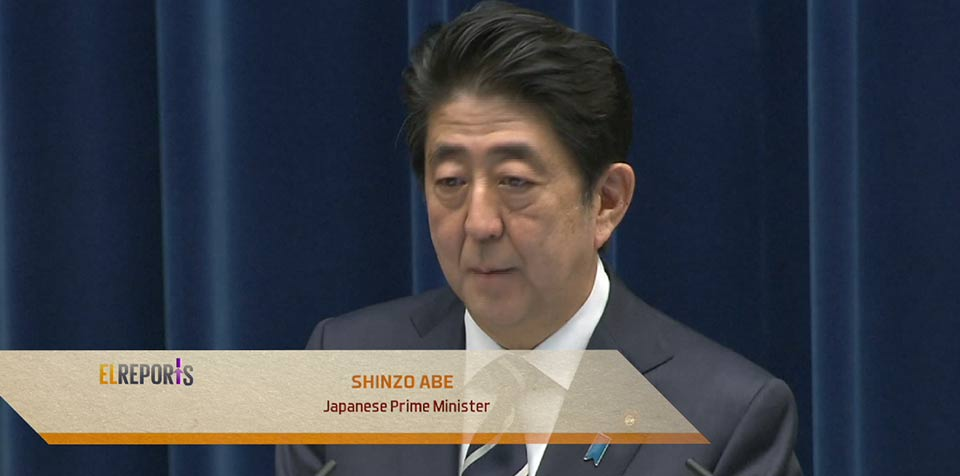 Japan passes record budget, security law takes effect